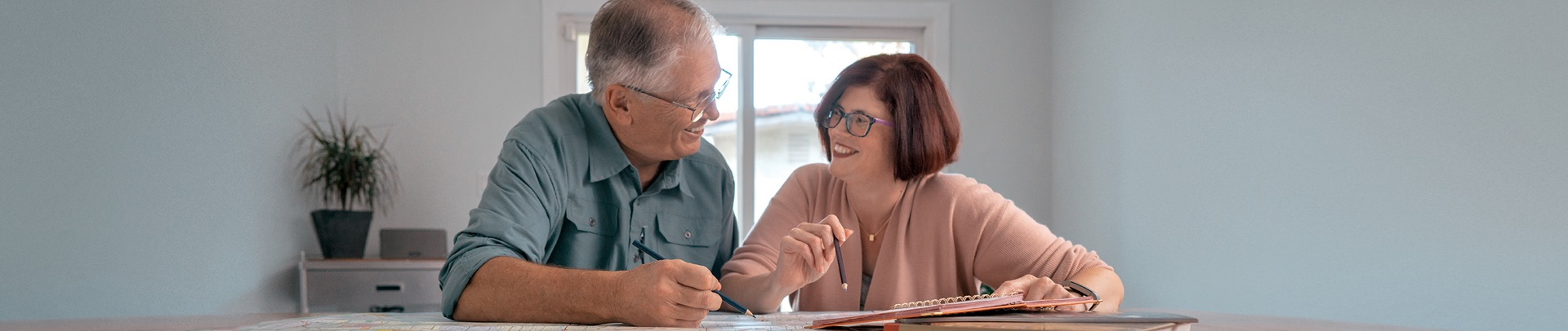 Ross and his wife Karen smile while consulting a map
